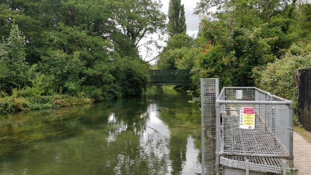 Metal fencing surrounding the inlet/outlet from the water treatment works into the Itchen Navigation