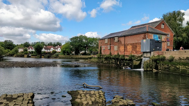 Upper reach of the tidal River Itchen, with the Woodmill building