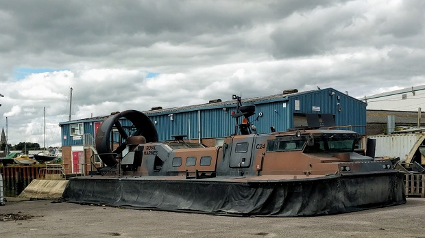 Royal Marines hovercraft with deflated skirts on hardstanding