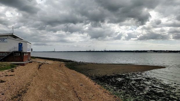 Sand and gravel foreshore, with the estuary water