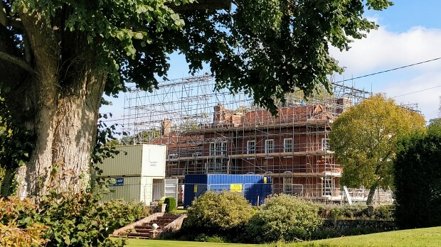 View of Ovington House, a late 18th century house undergoing extensive repairs.