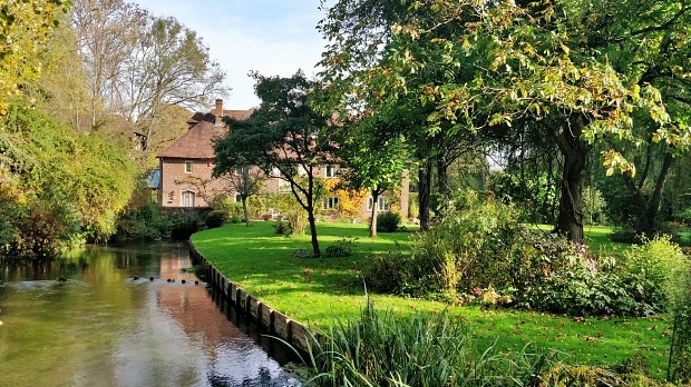 Old mill converted into a house with garden and the River Itchen.